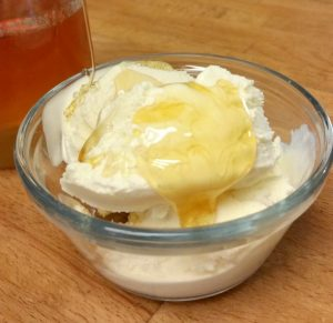 Honey is the first layer of flavor and sweetness in easy fried ice cream sundaes.