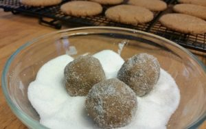 Ginger Snaps. Roll the dough in sugar and then flatten a bit before baking.