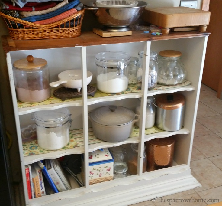 The top portion of a hutch flipped over to make extra shelves in the kitchen. and turning the base of the hutch into an island is not hard to do!