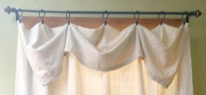 An easy no sew curtain using a painting drop cloth. Love it!