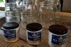 Using exterior paint samples helps make these painted Mason jars extra durable!