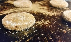 I flatten my ginger snaps with a glass dipped in sugar to prevent sticking