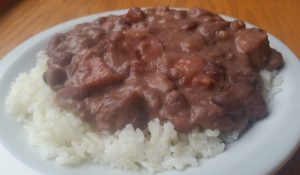 Easy Southern Red Beans and Rice with smoky sausage. It's the perfect frugal meal that is great for the freezer, too.